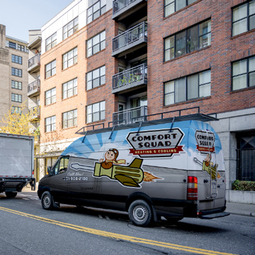 a van with advertising on the side on the road
