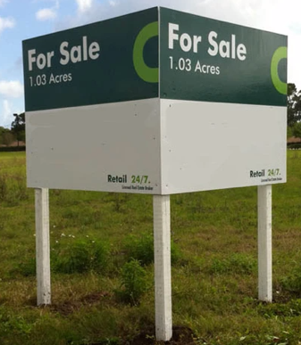 an outdoor land for sale sign